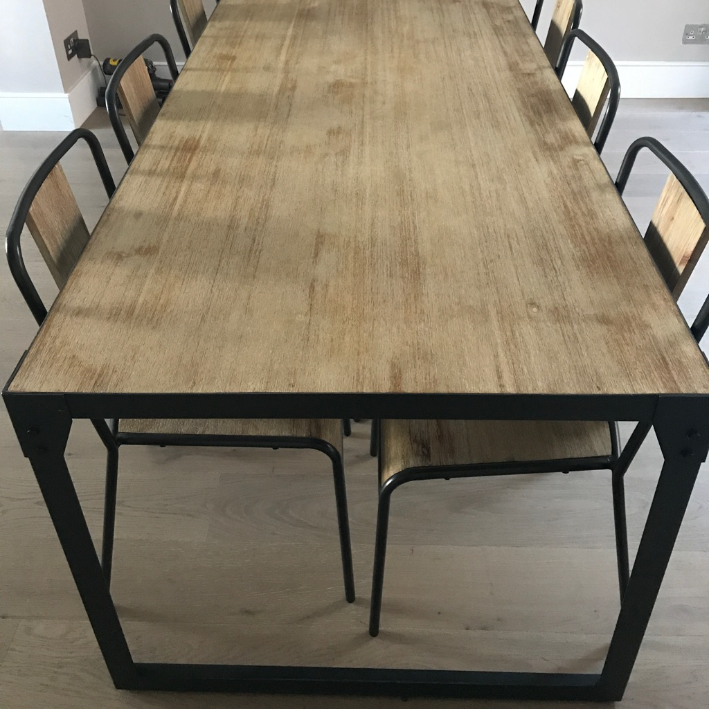 Dark grey and wooden six seater dining room table