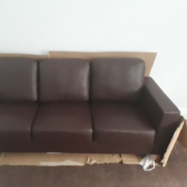 Brown chesterfield leather couch