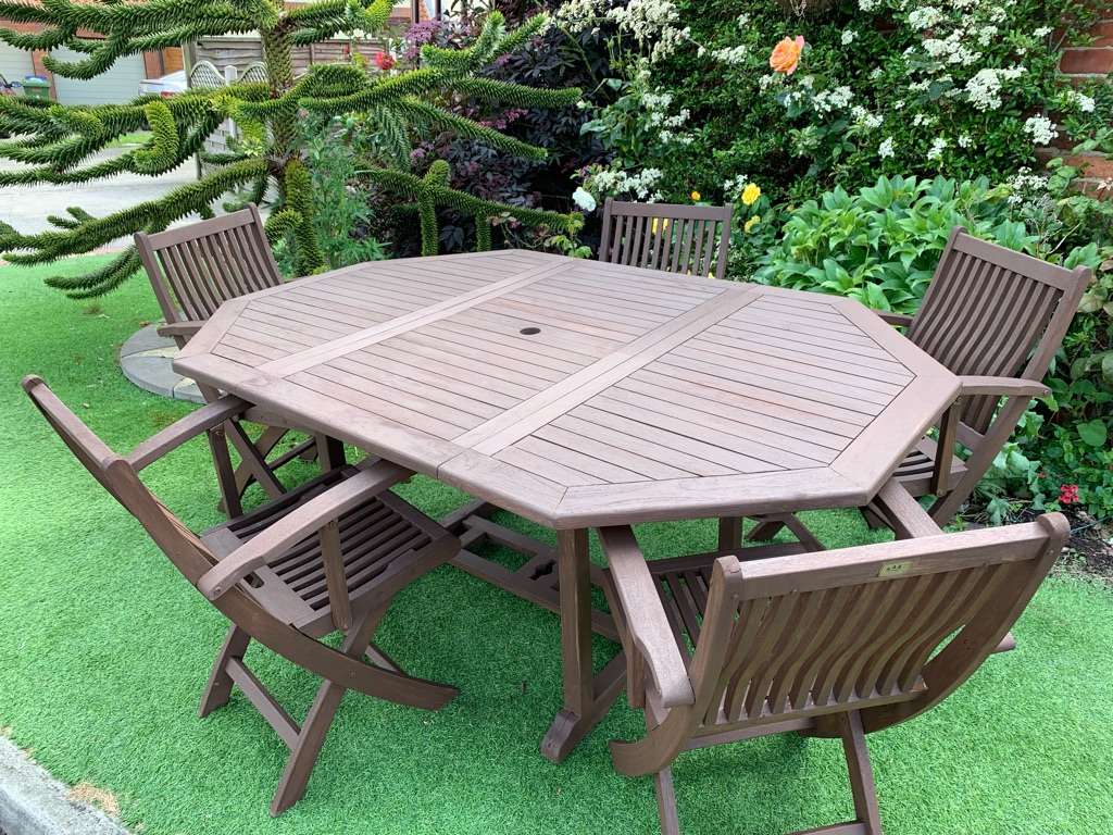 Solid teak garden table and x5 carver chairs extendable