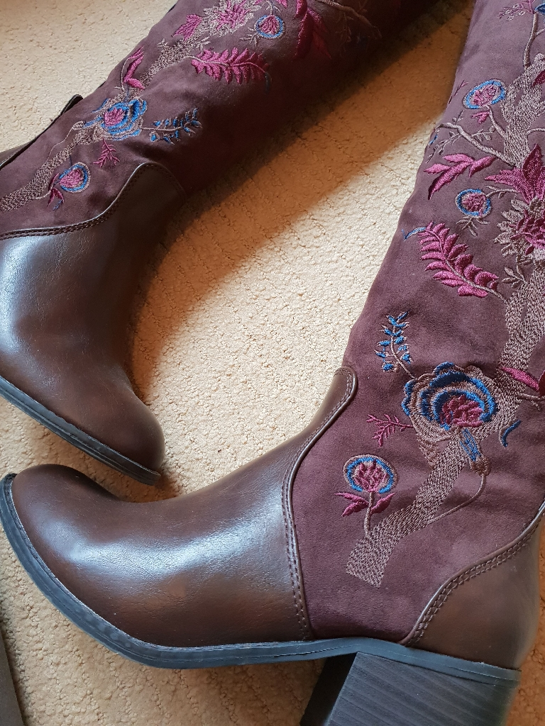 Brown embroidered knee high boots
