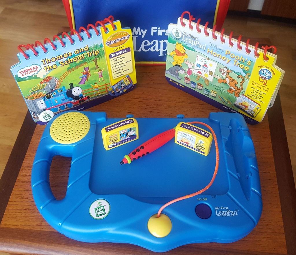 My first leap pad console by leapfrog with 2 games and backpack.