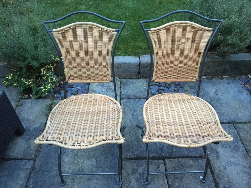 Two Foldable Wrought Iron and Wicker Chairs