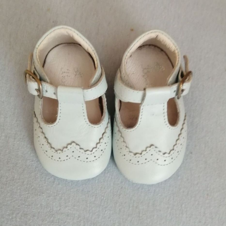 Tiny leather baby shoes