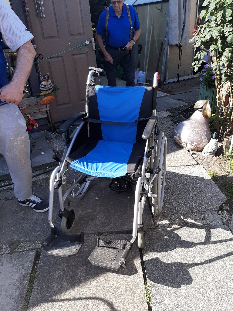 Wheelchair with portable motor