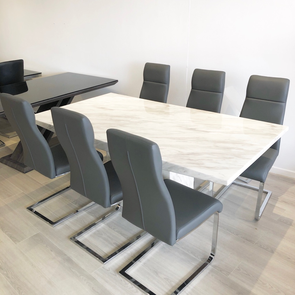 Harvey's new marble real dining table with Harvey's chairs