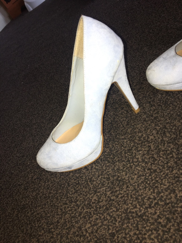 Blue suede heels and red suede heels