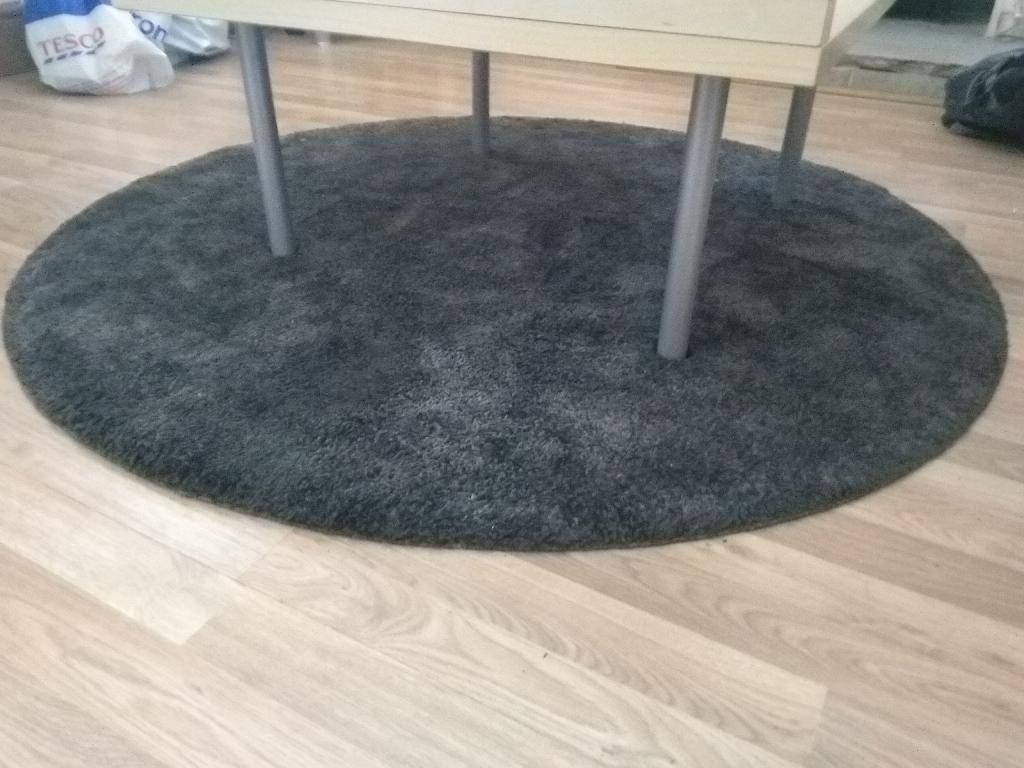 Black circular rug