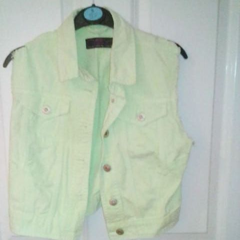 Green denim jacket.