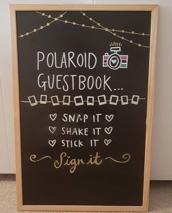 Polaroid guestbook blackboard sign
