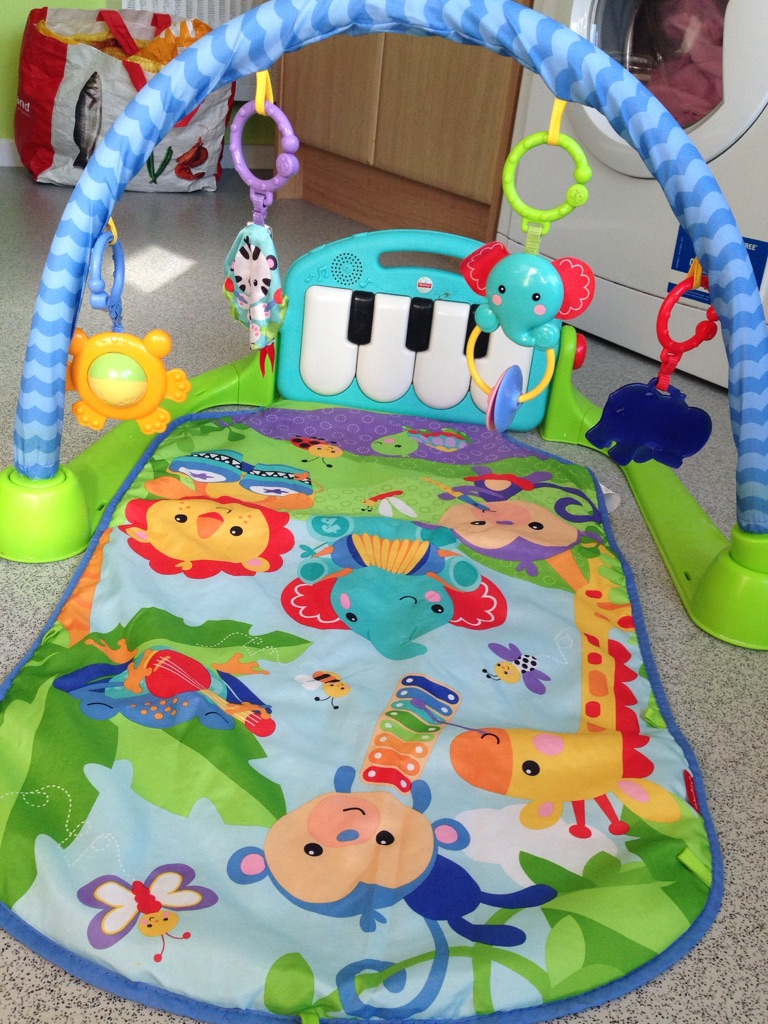 Fisher price kick & piano play gym.