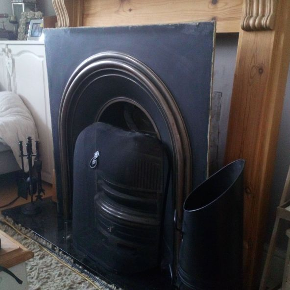 Beautiful cast iron fire surround with granite hearth and pine fire surround