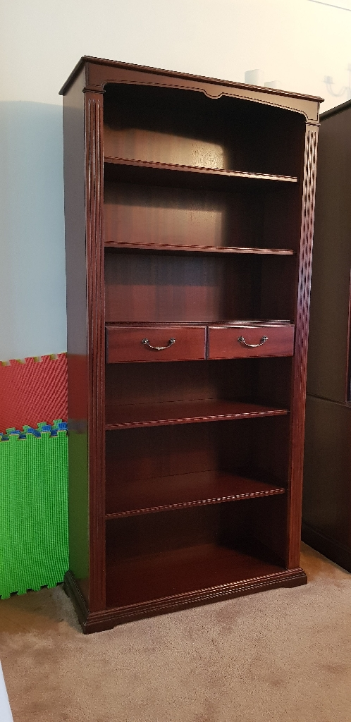 Tall mahogany bookcase (or display unit) with middle drawers