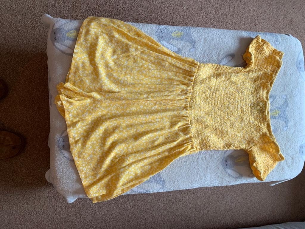 Girls yellow playsuit age 13.