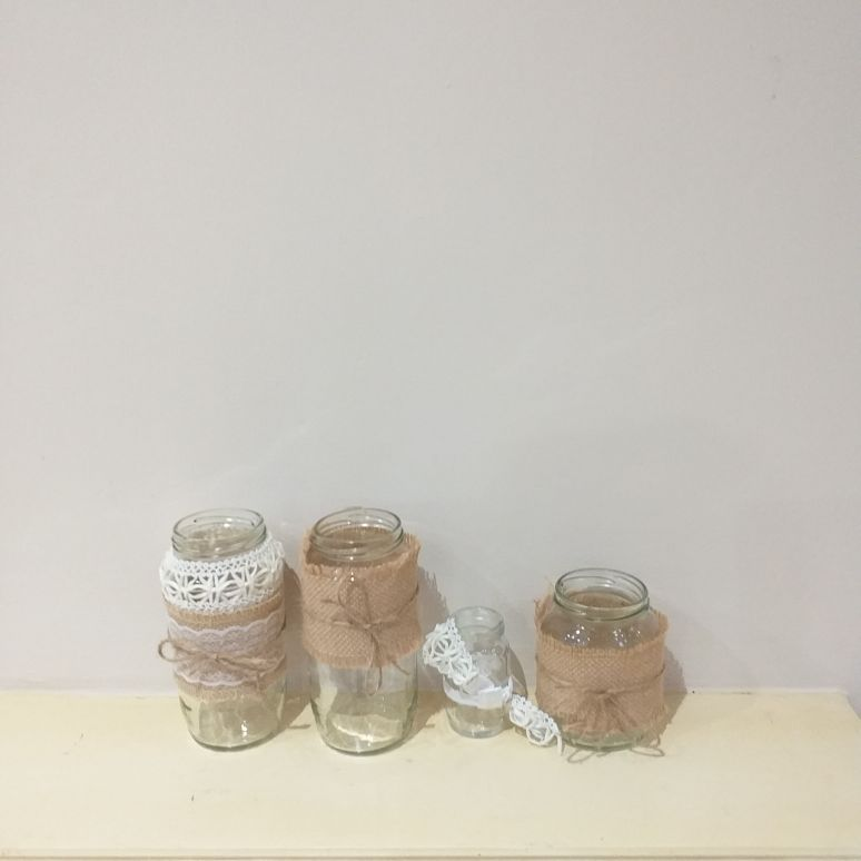 Glass vases with hessian and lace