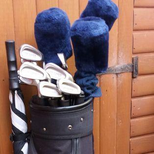 half set of golf clubs