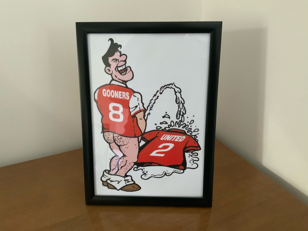 Arsenal pee United shirt picture frame