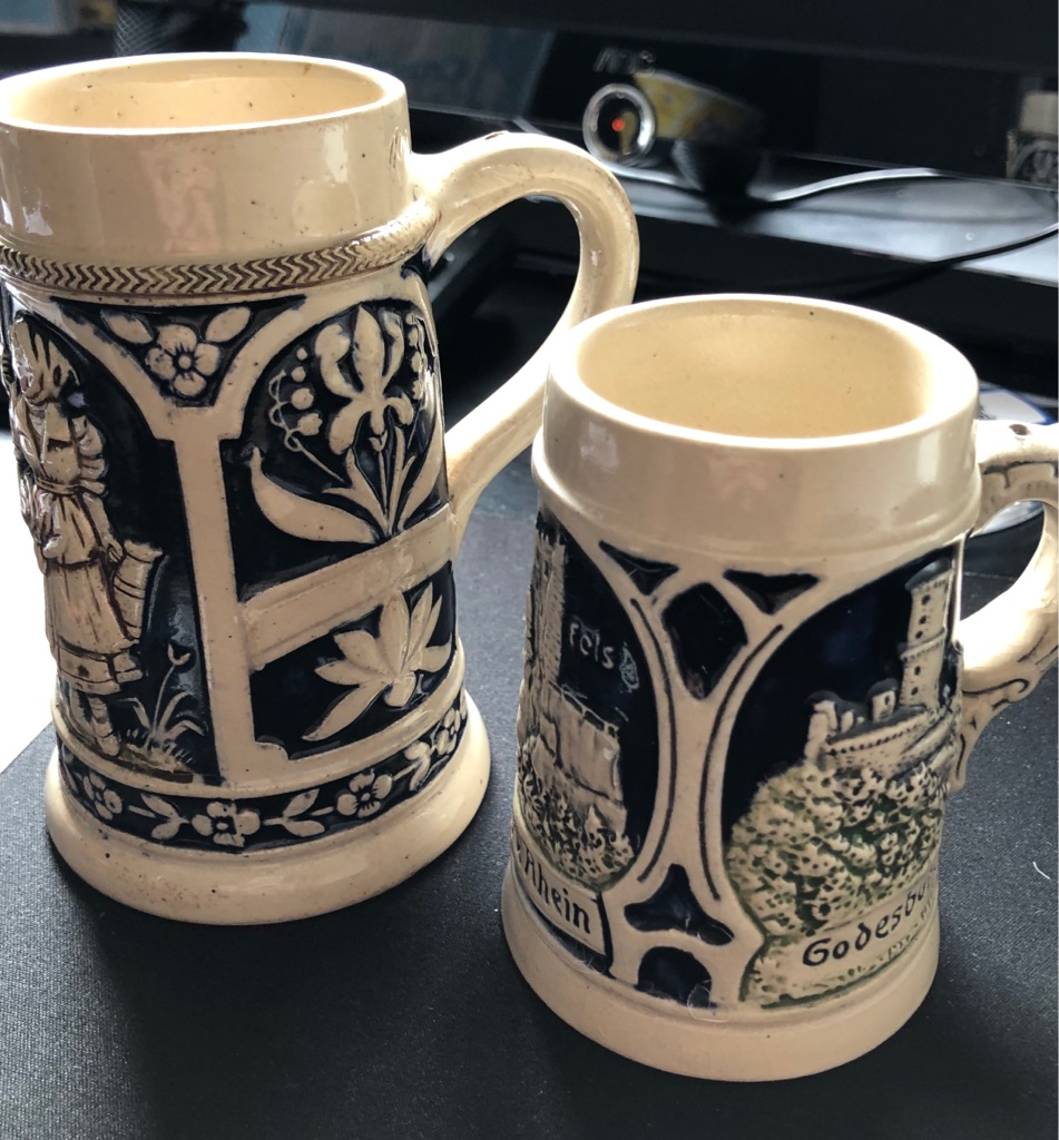 TWO POTTERY ORNAMENTAL GERMAN TANKARDS