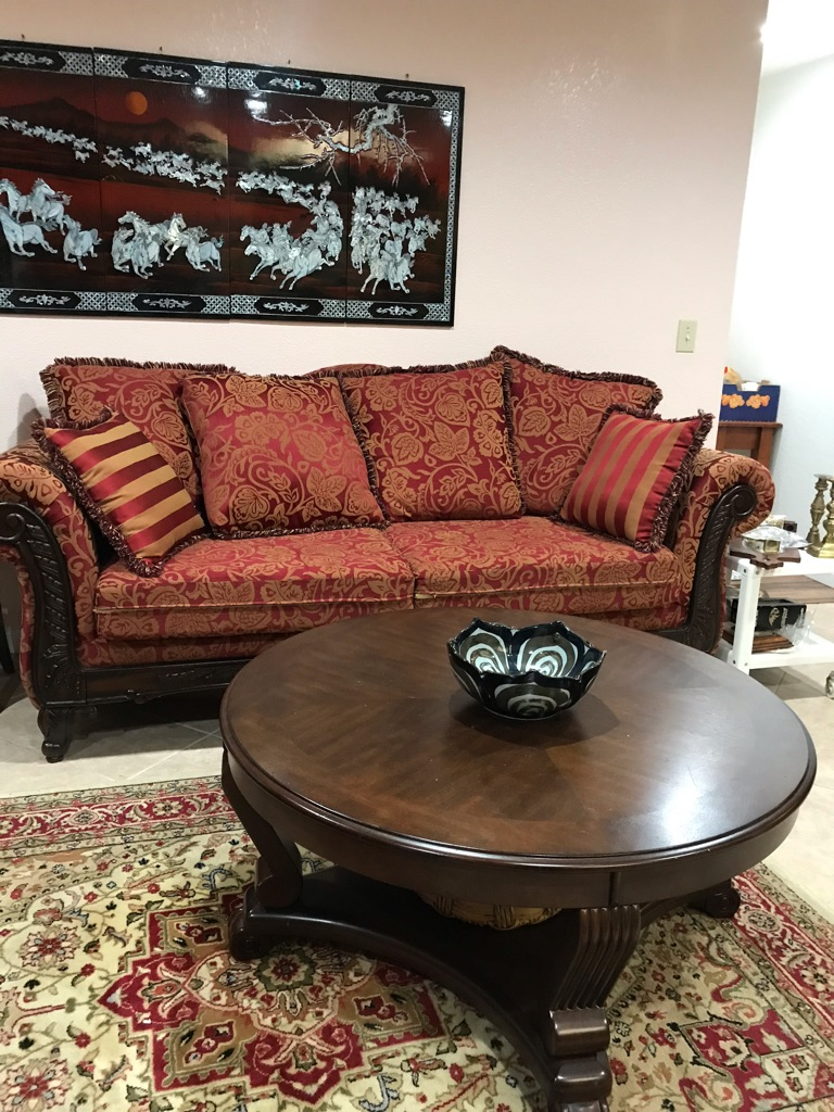 Red couch. In good condition