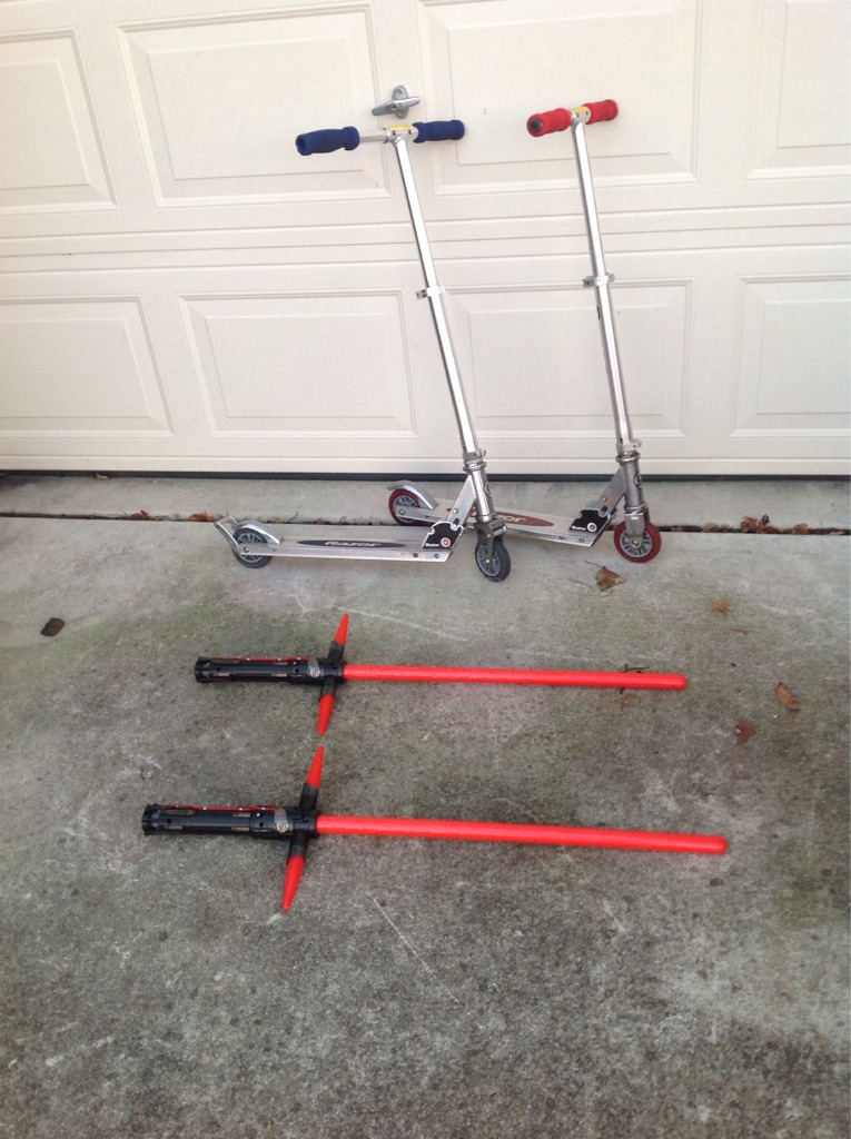 2 razor Scooters and 2 light Sabers