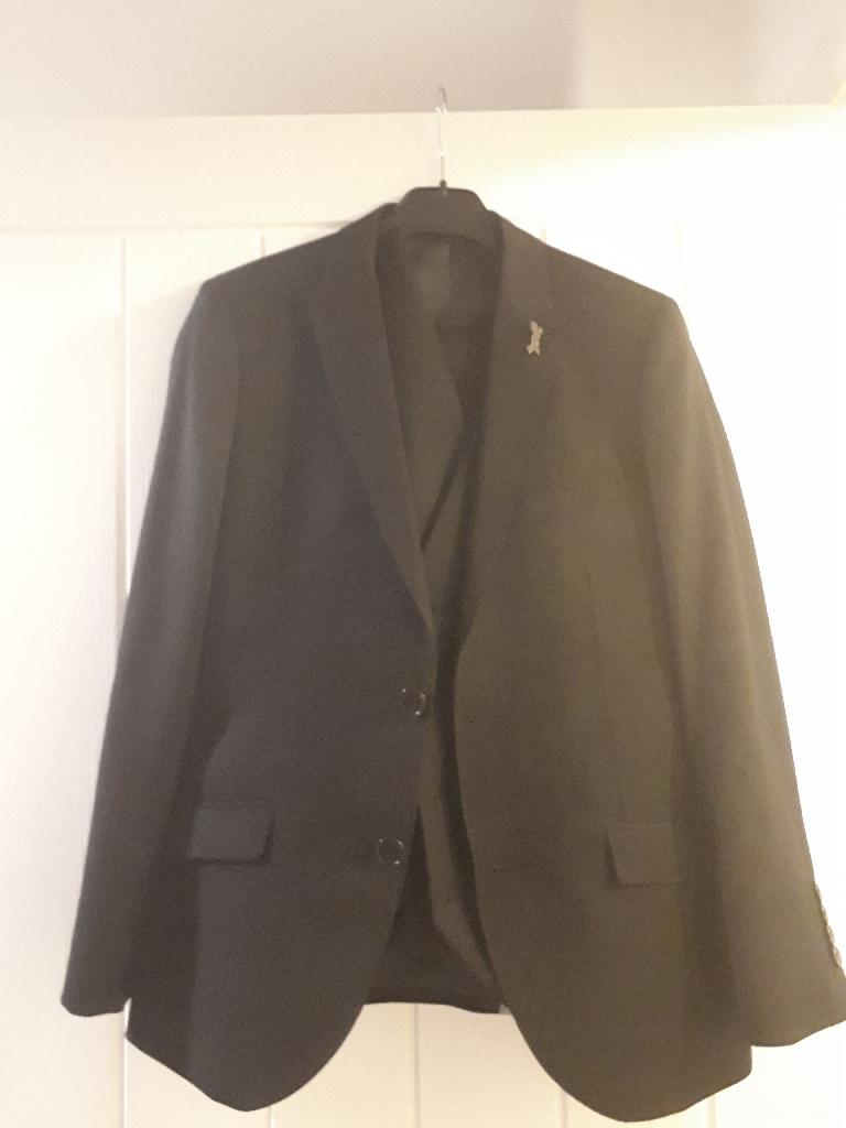 Boys black suit with waistcoat, white shirt, grey faux leather jacket and grey bomber jacket