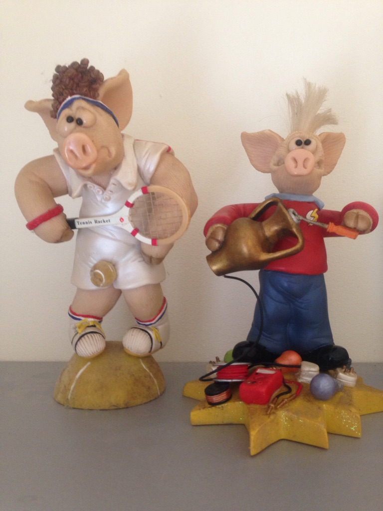 Two piggin bright spark figures