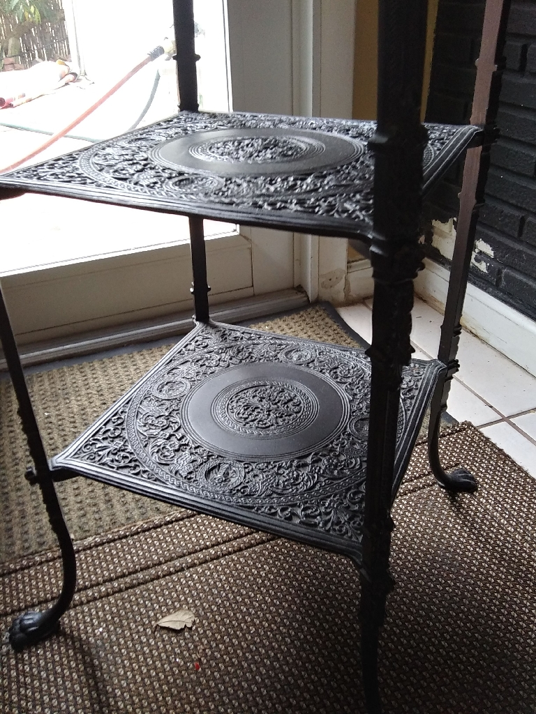 Used 3 tier/shelves vintage, adjustable legs, cast metal black stand. Paint chipped on the top shelf.
