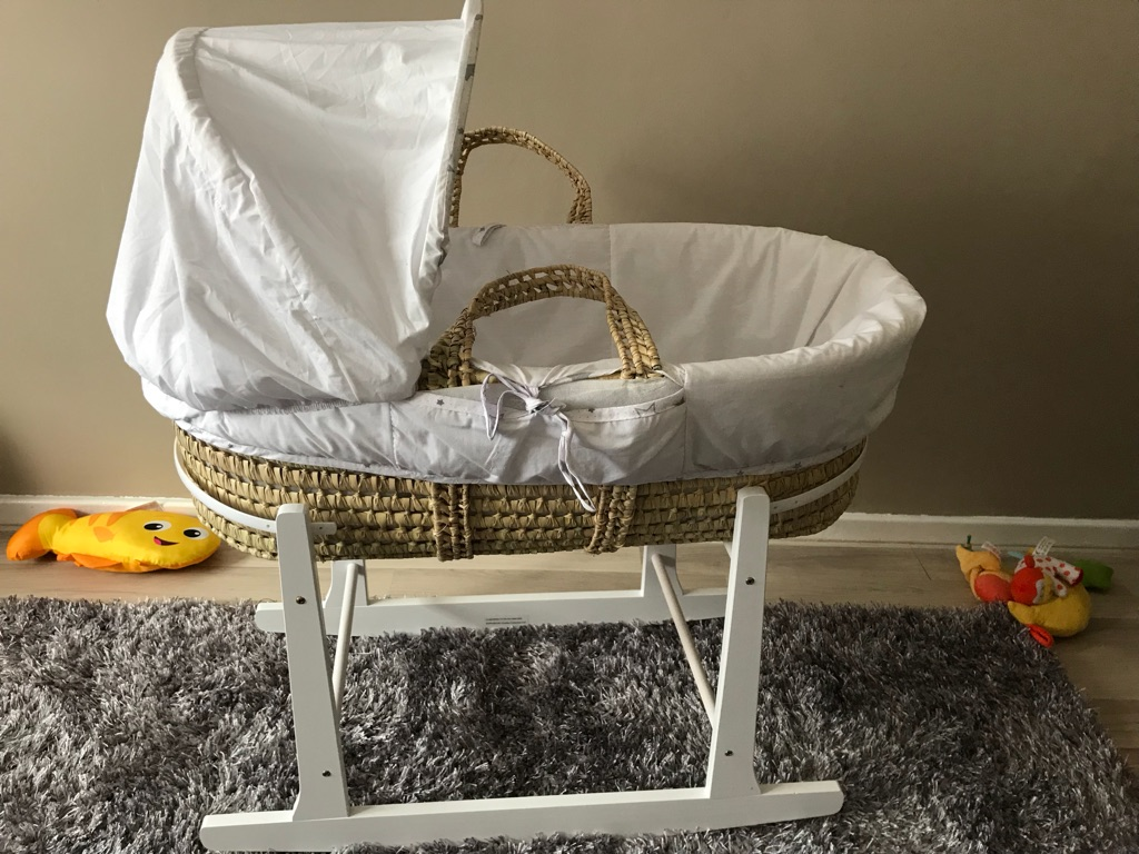 Moses basket it's rocking stand