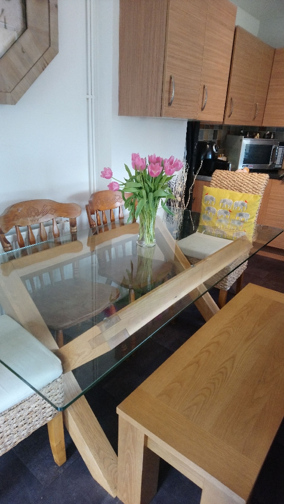 Solid oak dining table wth bench and matching coffee table seats 6 to 8 excellent quality