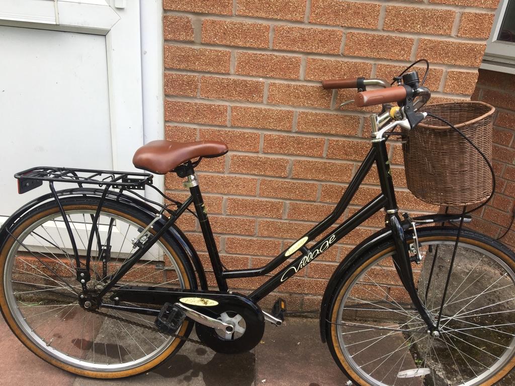 Black and orange vintage bike with wicker basket