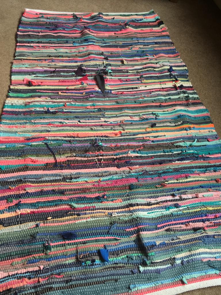 Brightly coloured rag rug