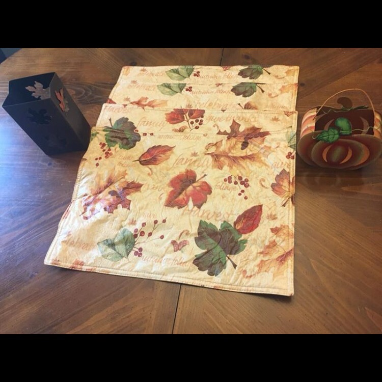4 fall plastic placemats and 2 fall metal tea light holders