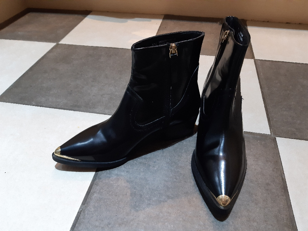 Black patent boots with gold cap on tip