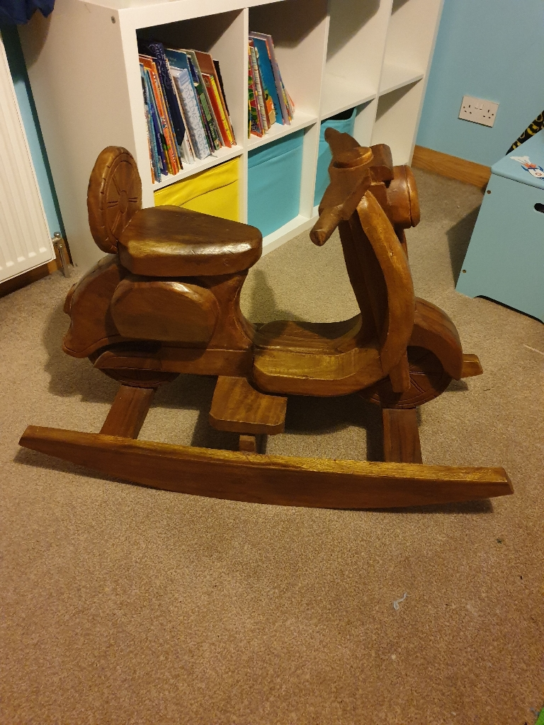 Solid wood scooter seesaw