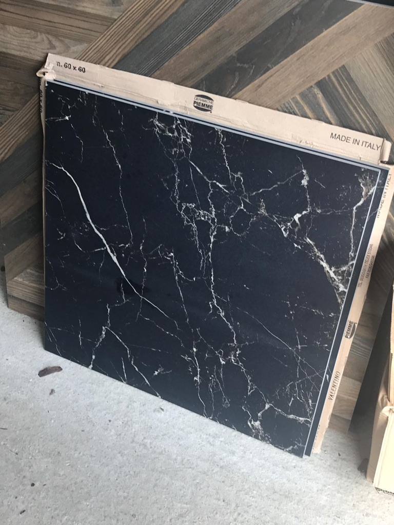 600x600 Black Marble tile. 8 tiles available. £20