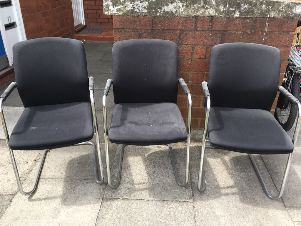 3x black chairs