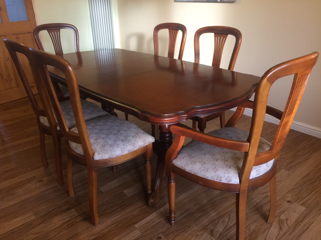 Dining table with 6 chairs, 2 are carver and matching corner unit