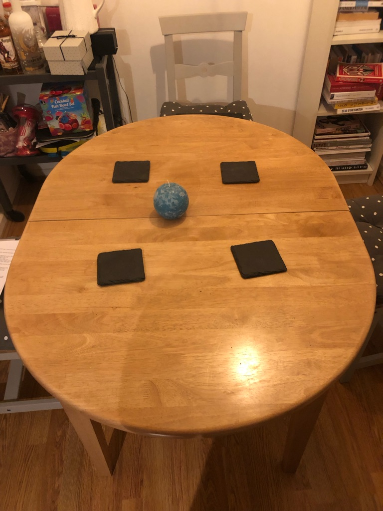 Dining table extends to sit 6
