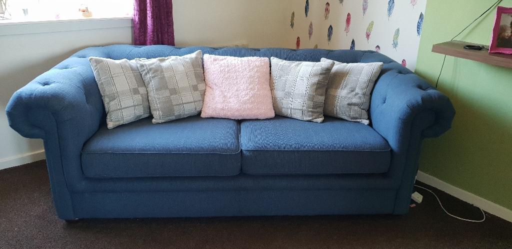 2 blue fabric sofas