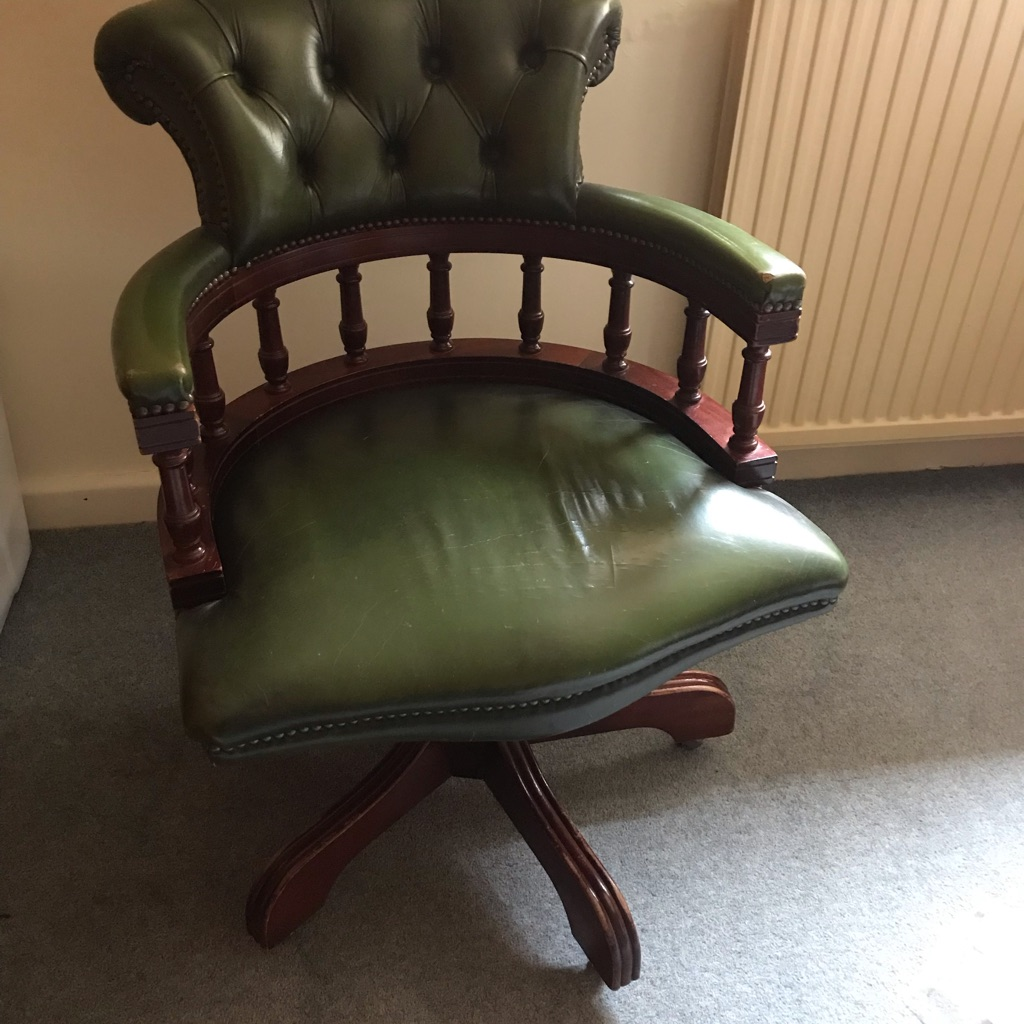 Green leather revolving office desk chair
