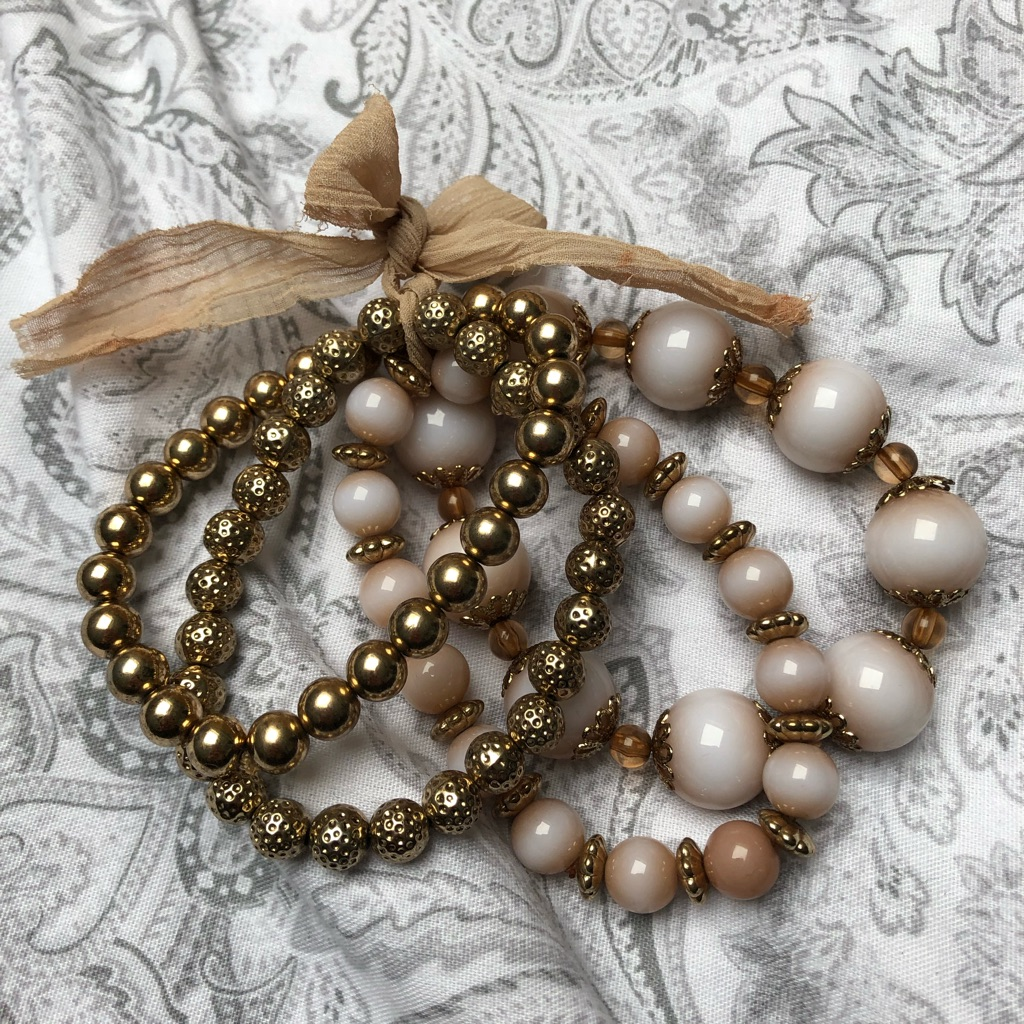 Nude and gold bracelets