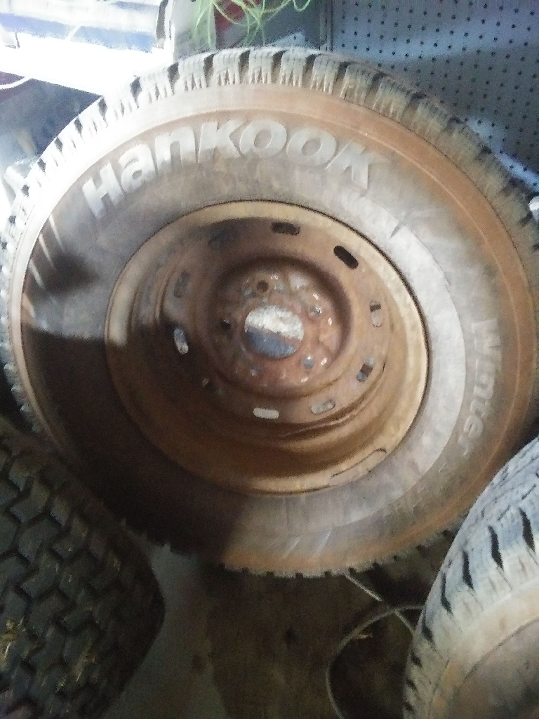 Two tires on rims 235/75/15