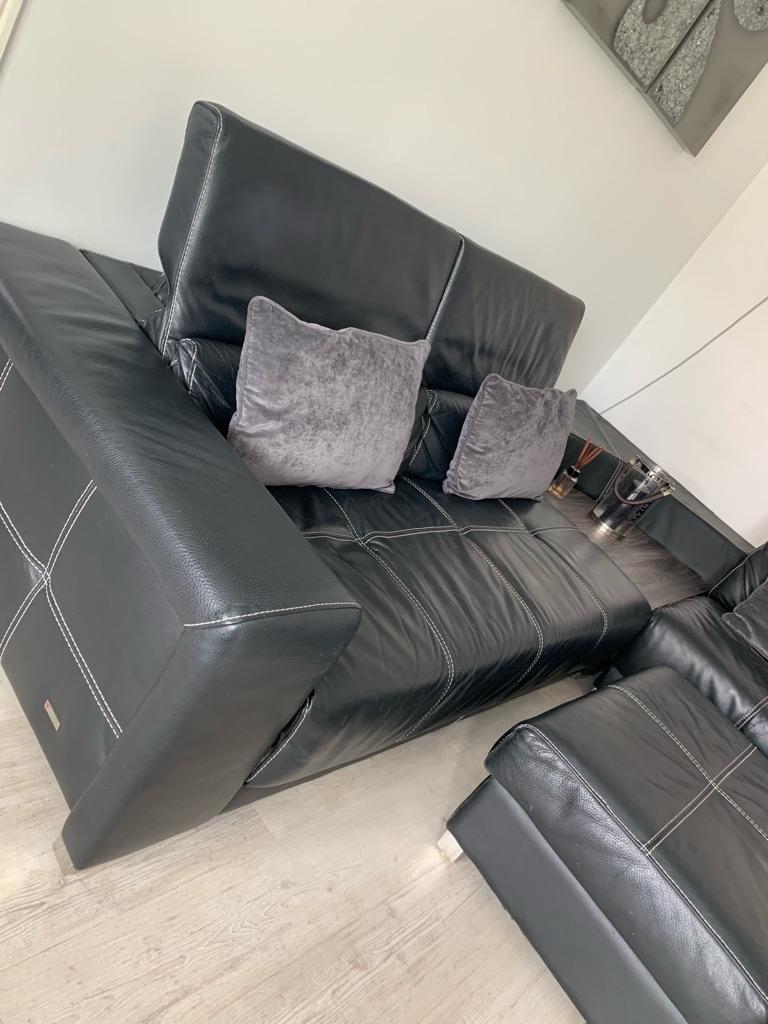 Black corner sofa with side table