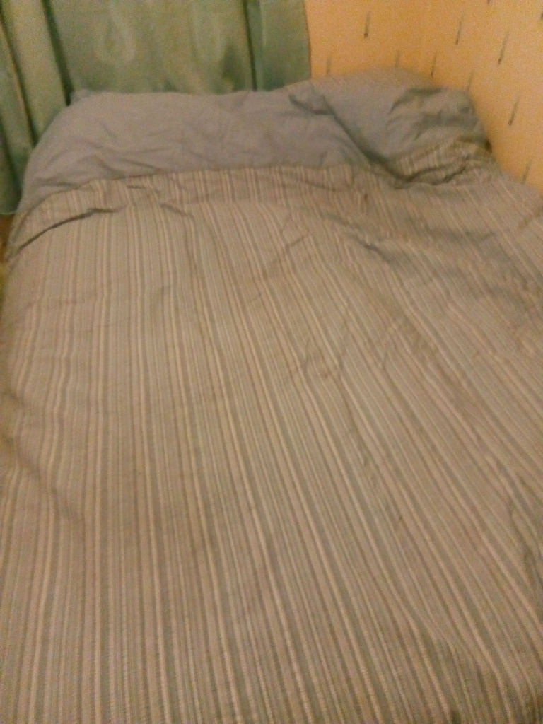 Double divan bed with bedding