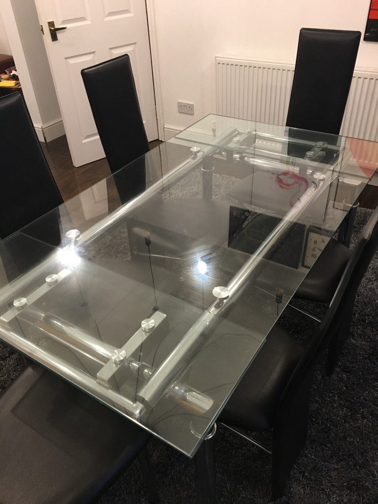 Glass dining table extending 8 chairs