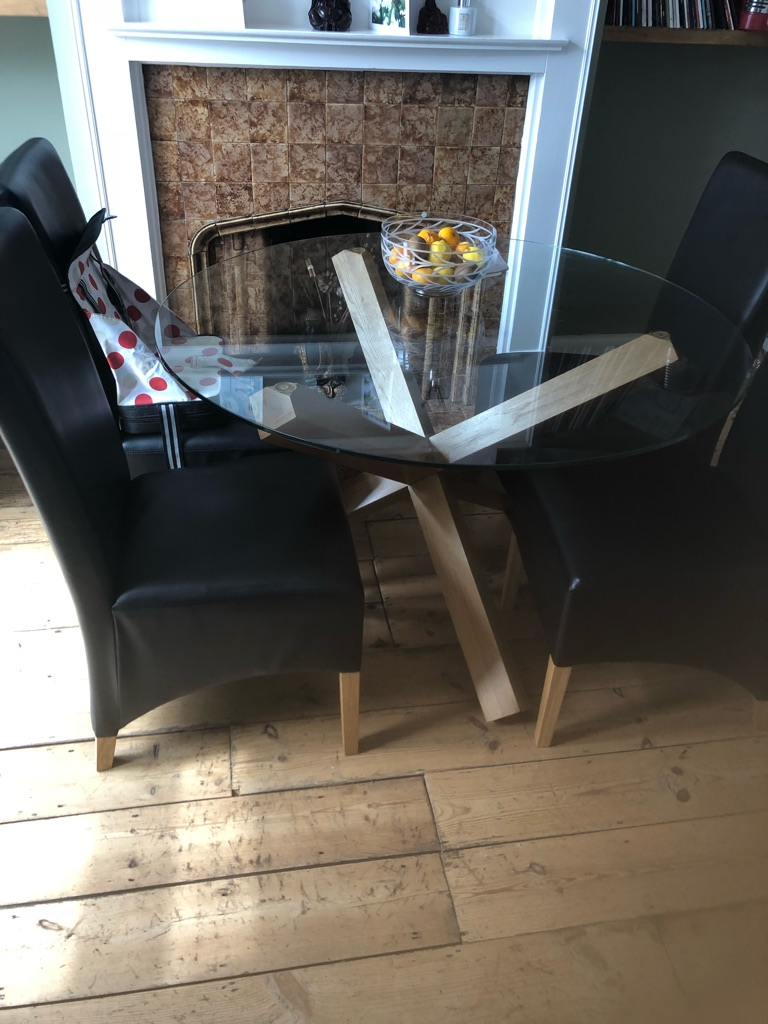 Glass dinning table and 4 brown leather chairs