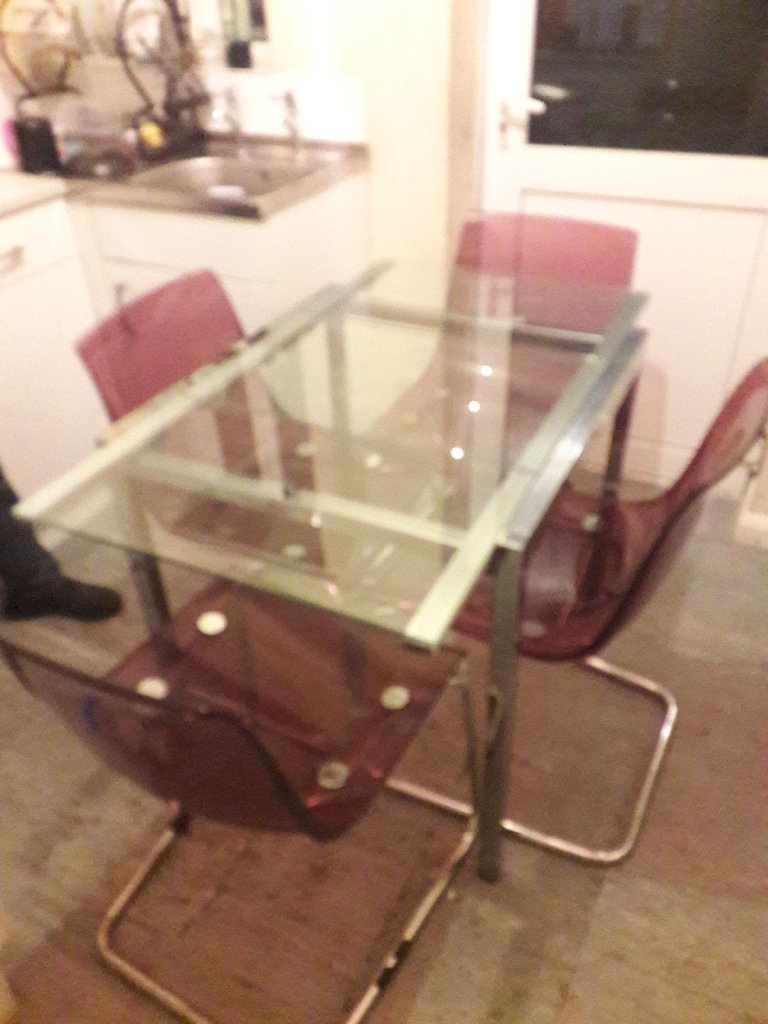 Extendable solid glass dining table and four chairs