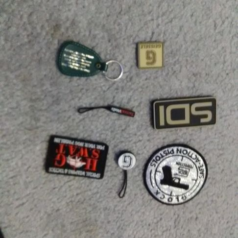 Collectible gun patches and zipper pulls