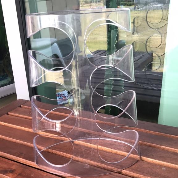 Umbra clear Perspex wine rack