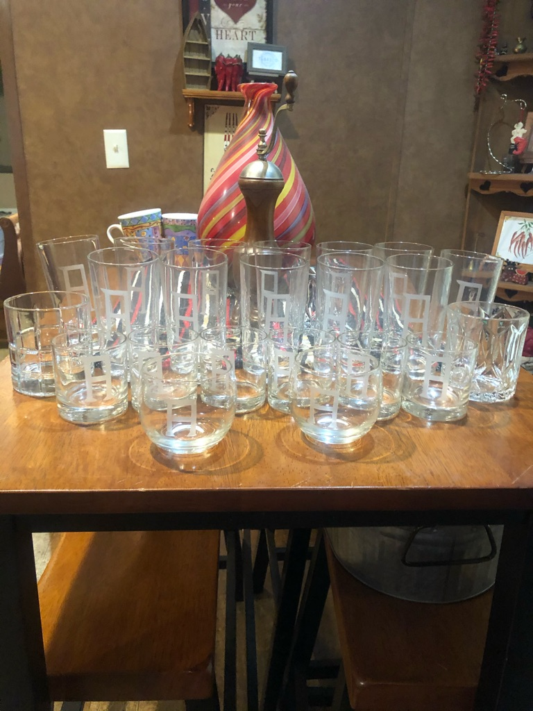 "Complete set of drinking glassware etched with the letter ""A"" on all. About 20 pieces. Great as a gift, a collectors item, or everyday use."