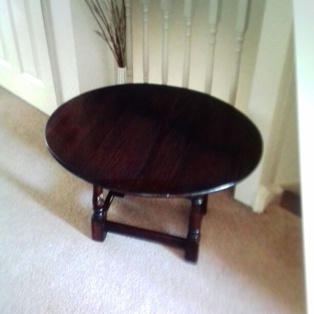 Dark mahogany  drop down side occasion table.